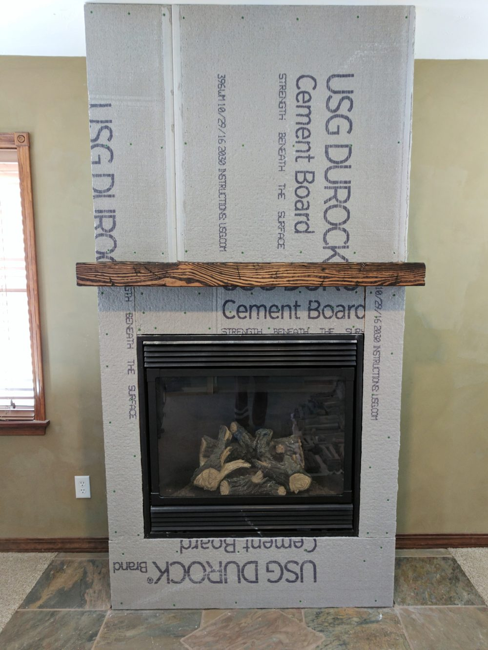 Fireplace remodel with durock cement board and mantel installed