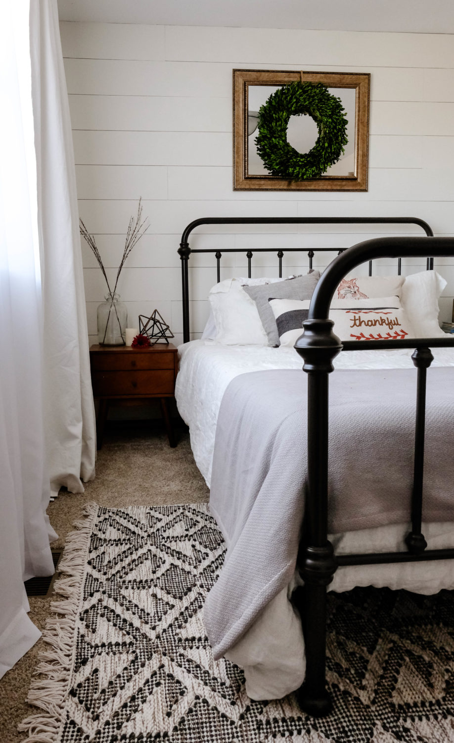 farmhouse bedroom with bed and rug