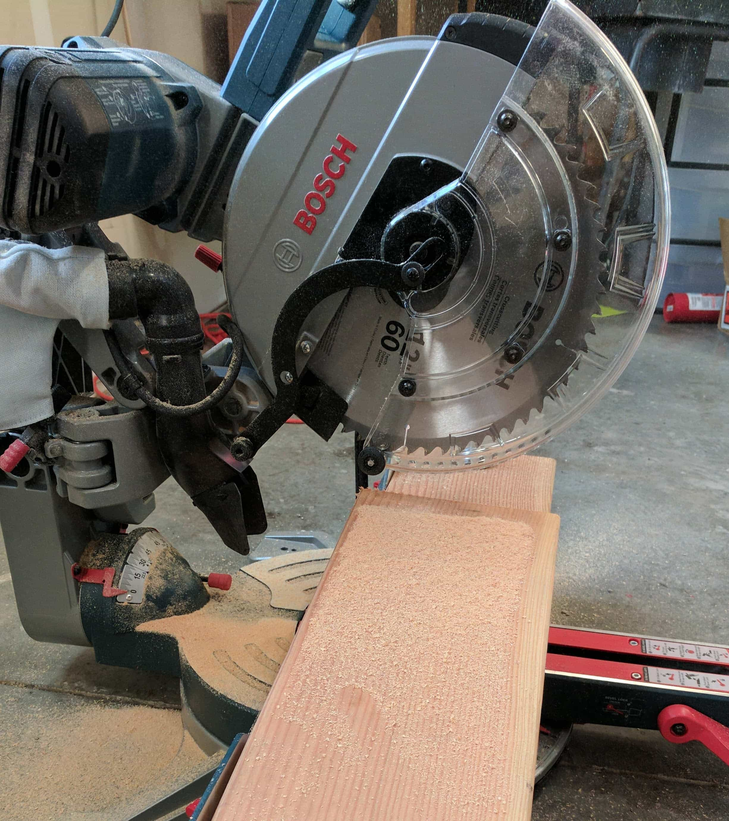 Bosch Miter Saw after cutting boards for a DIY Wood Plank Accent Wall