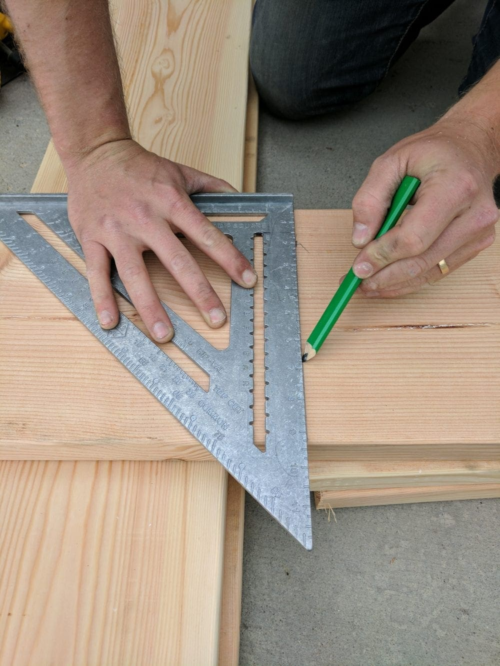 "Using a speed square to mark 2"" x 10"" lumber"