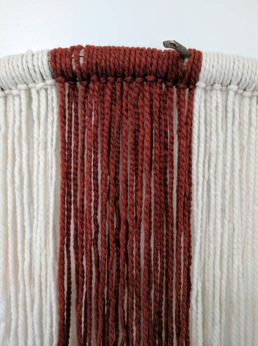close-up of the DIY wall hanging yarn