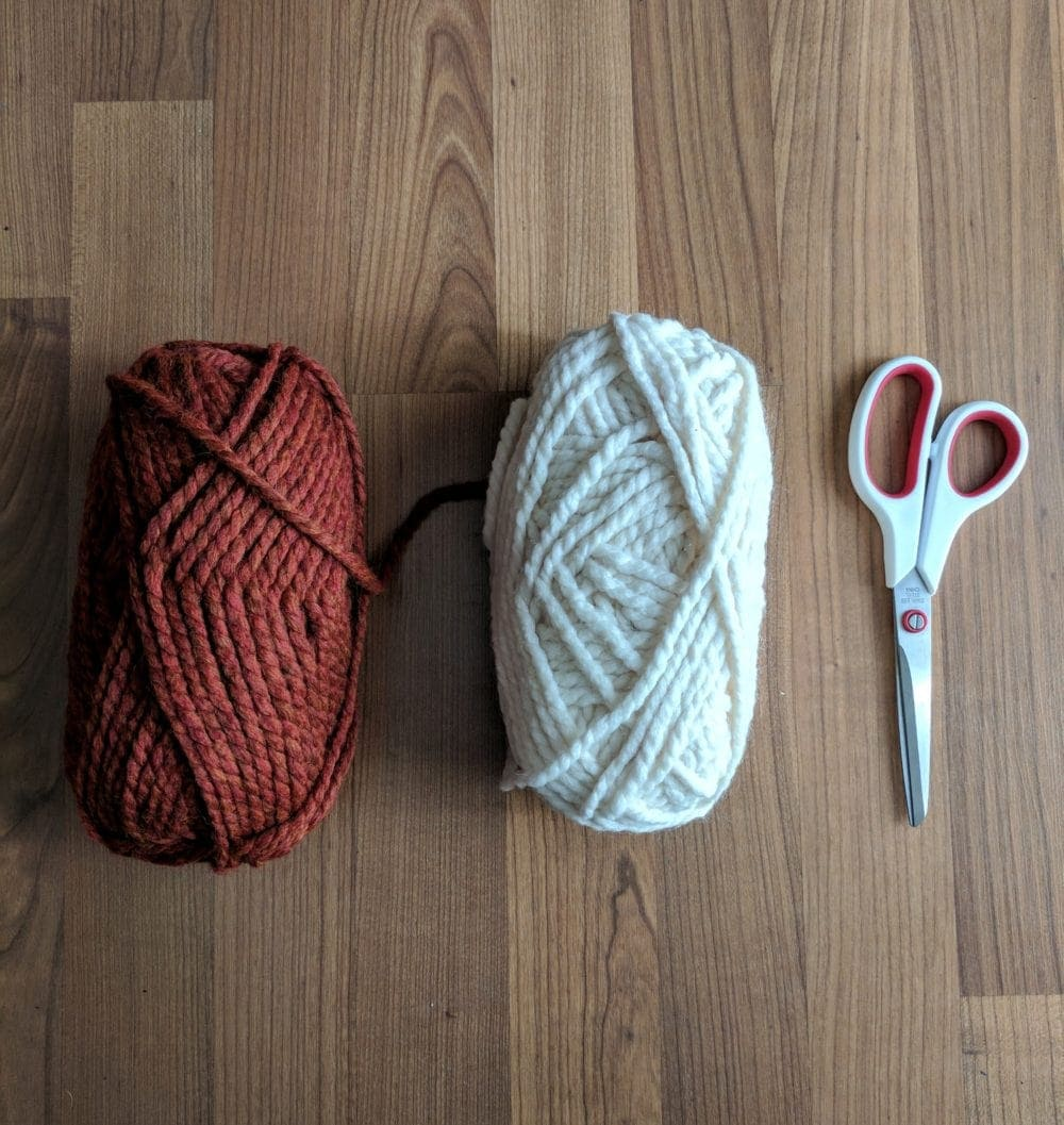 yarn and scissors for making a DIY wall hanging