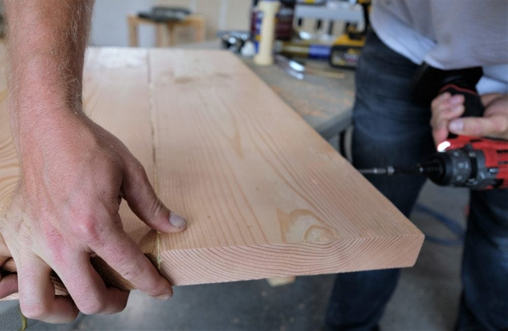 screwing boards together to make rustic coffee table