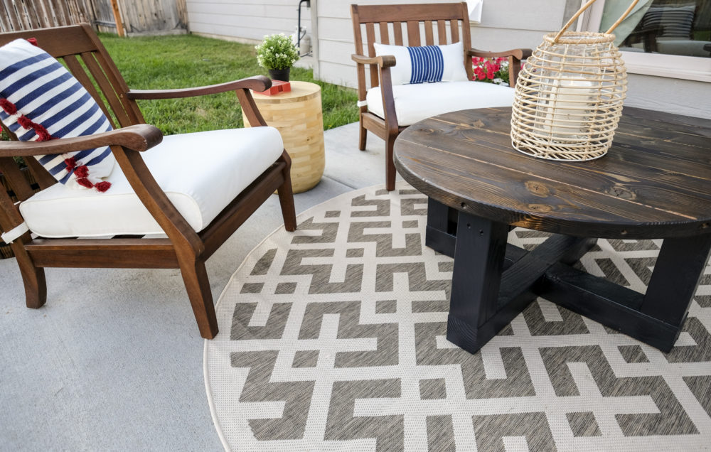 outdoor patio makeover with a coffee table and outdoor rug