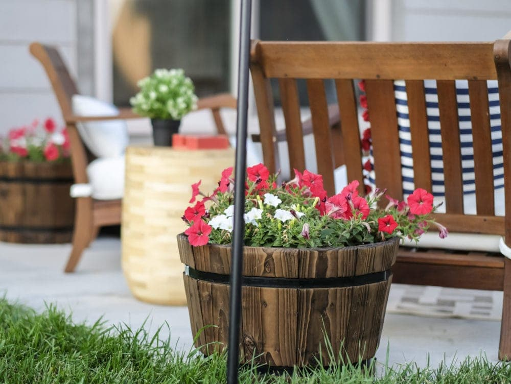 outdoor patio with small whiskey barrels used as flower pots