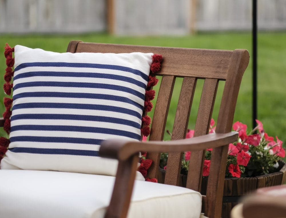 outdoor patio chair with throw pillow