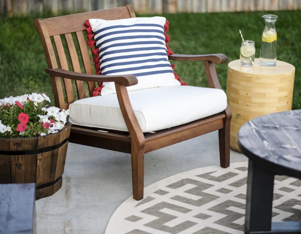 outdoor patio makeover with wood chairs and throw pillows