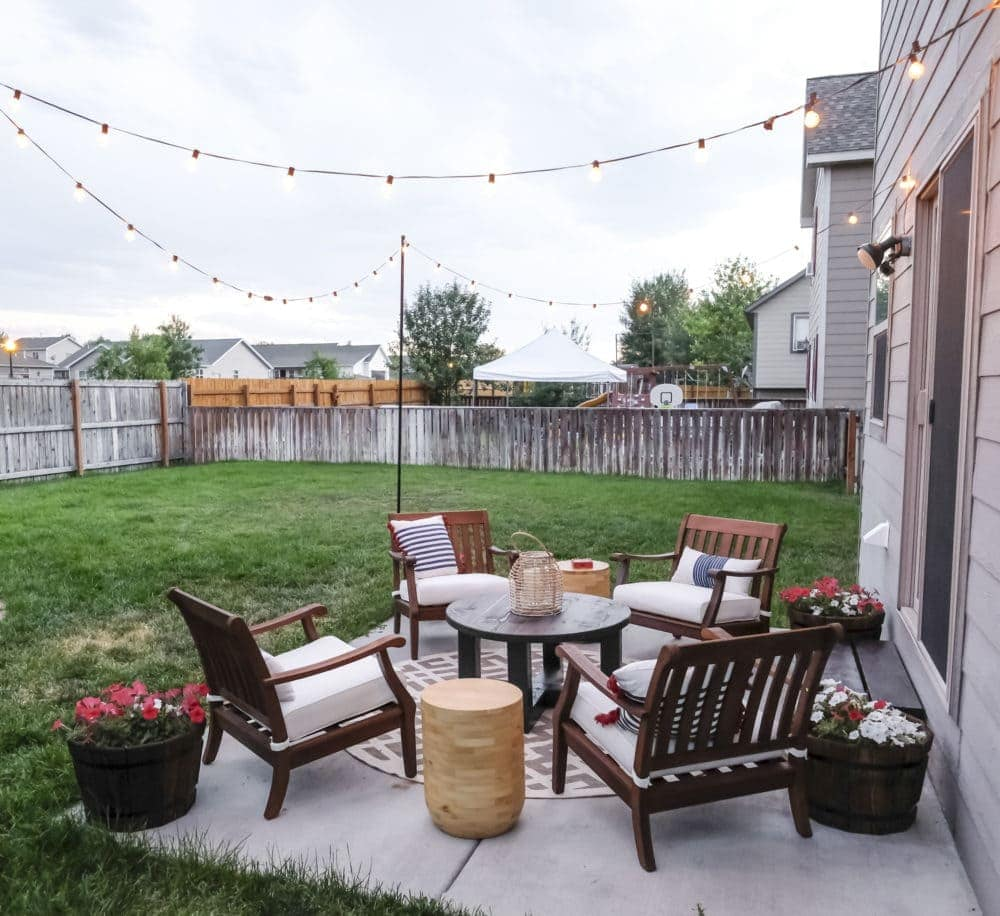 outdoor patio makeover with string lights and lots of seating