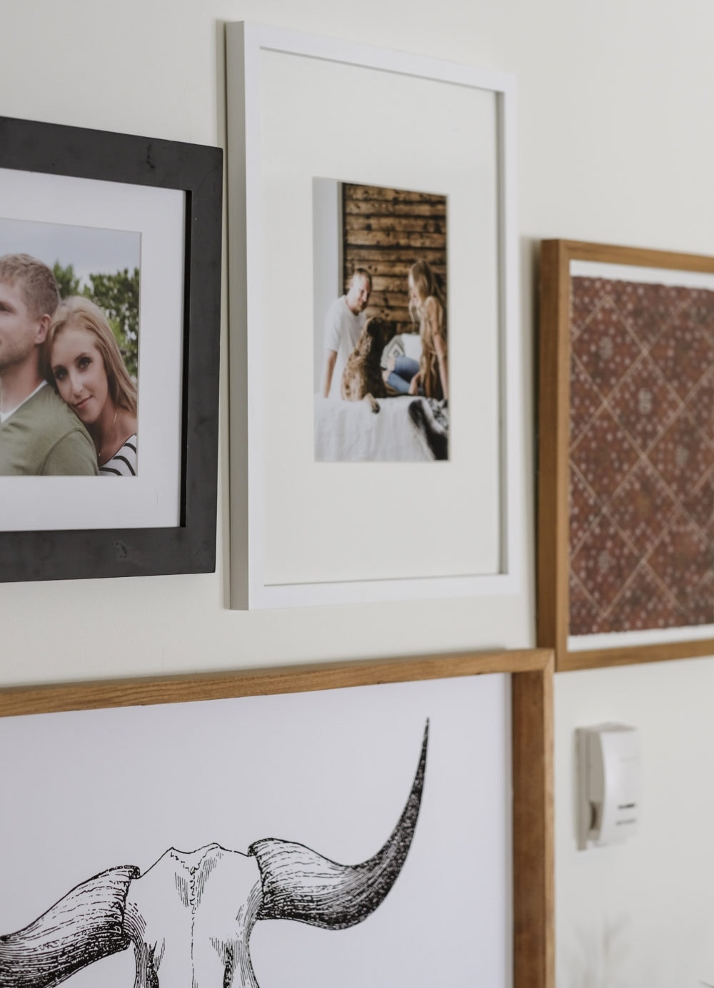 a gallery wall with printables, and pictures