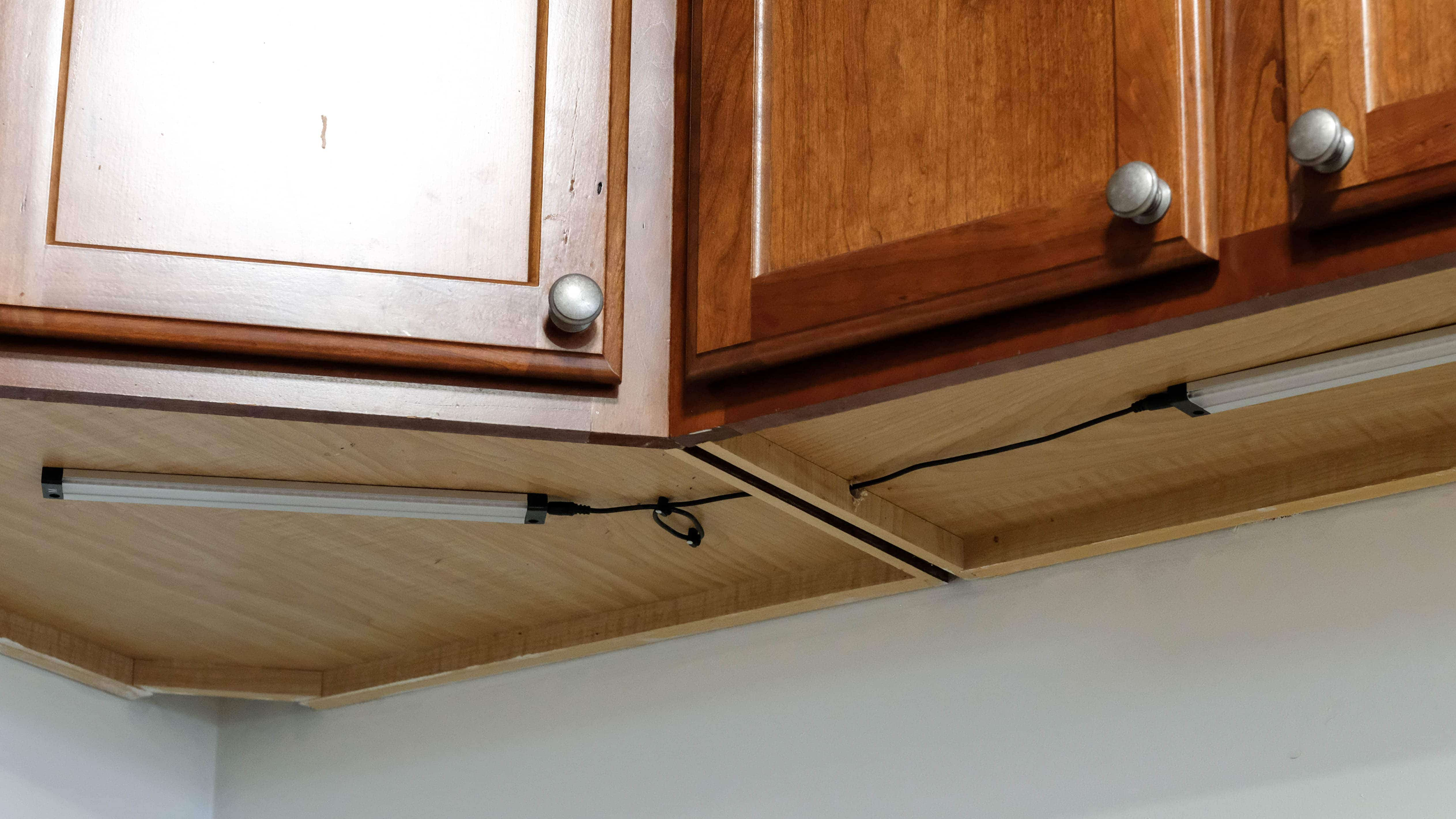 close up of under cabinet lighting and wiring in a kitcen
