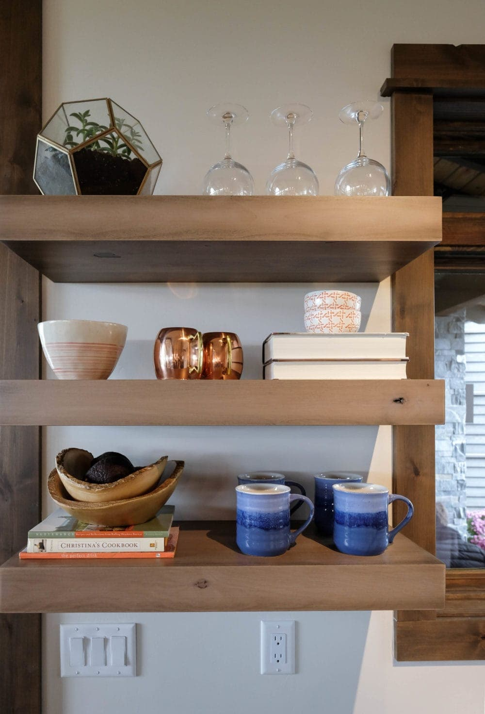Parade of Homes styled shelf with cups, books, and other decor