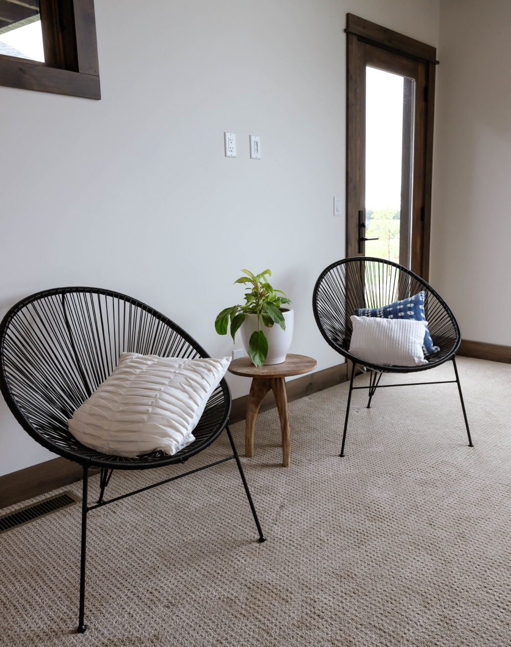 Parade of Homes living room with two mesh net chairs