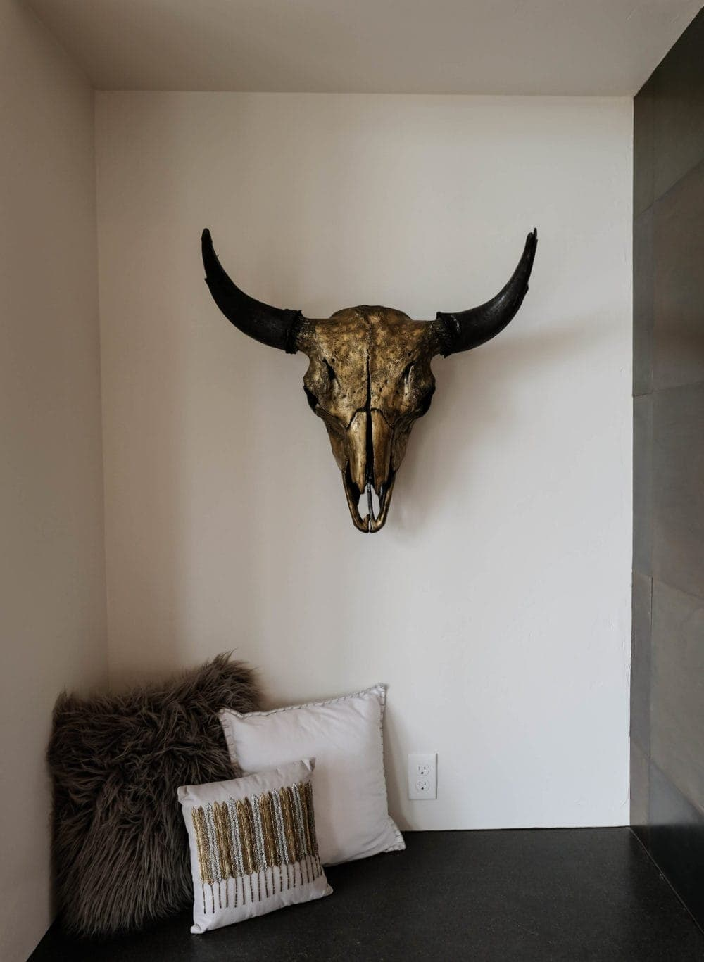 Parade of Homes gold bull skull and horns