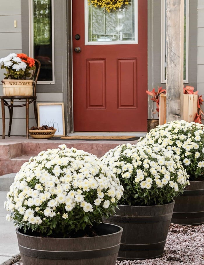 fall front porch decorated with flowers