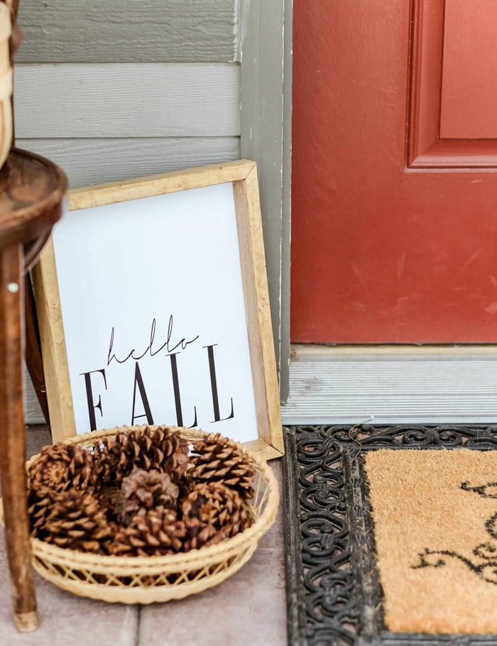 small front porch decorated for fall with a framed free printable