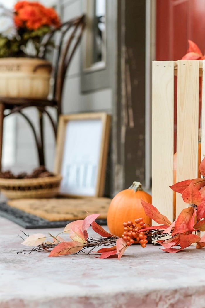 fall front porch decorated with pumpkins and other decor