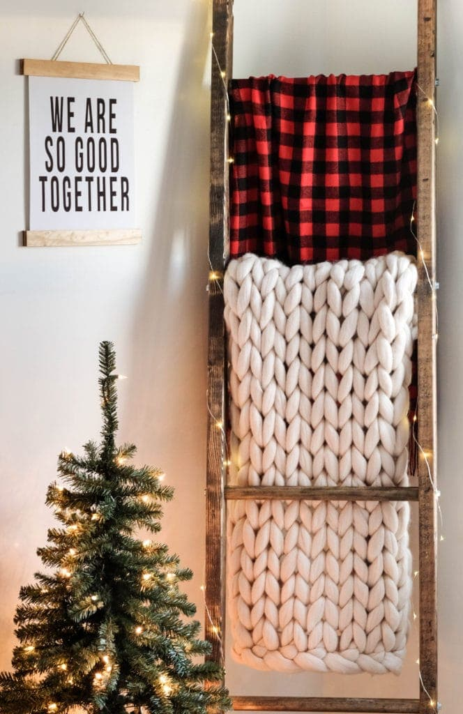 a blanket ladder styled for the holidays