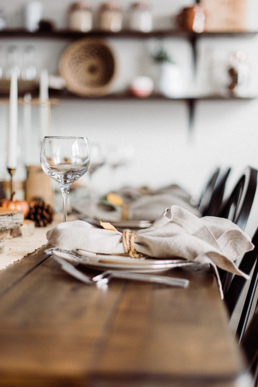 thanksgiving table place setting with wine glass