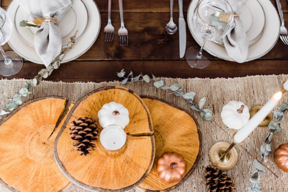rustic thanksgiving centerpiece with tree slices and pinecones