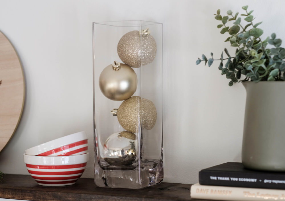Christmas decor idea using a vase filled with christmas ornaments