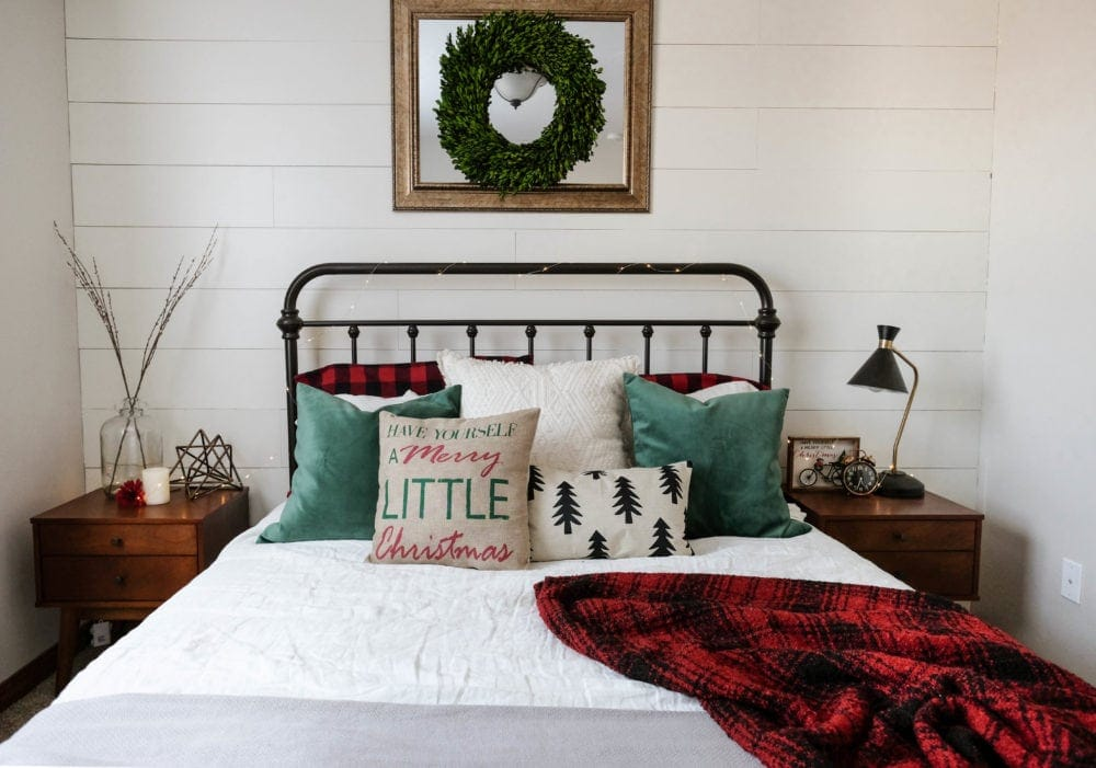 Christmas bedroom decor ideas with throw pillows and a flannel blanket