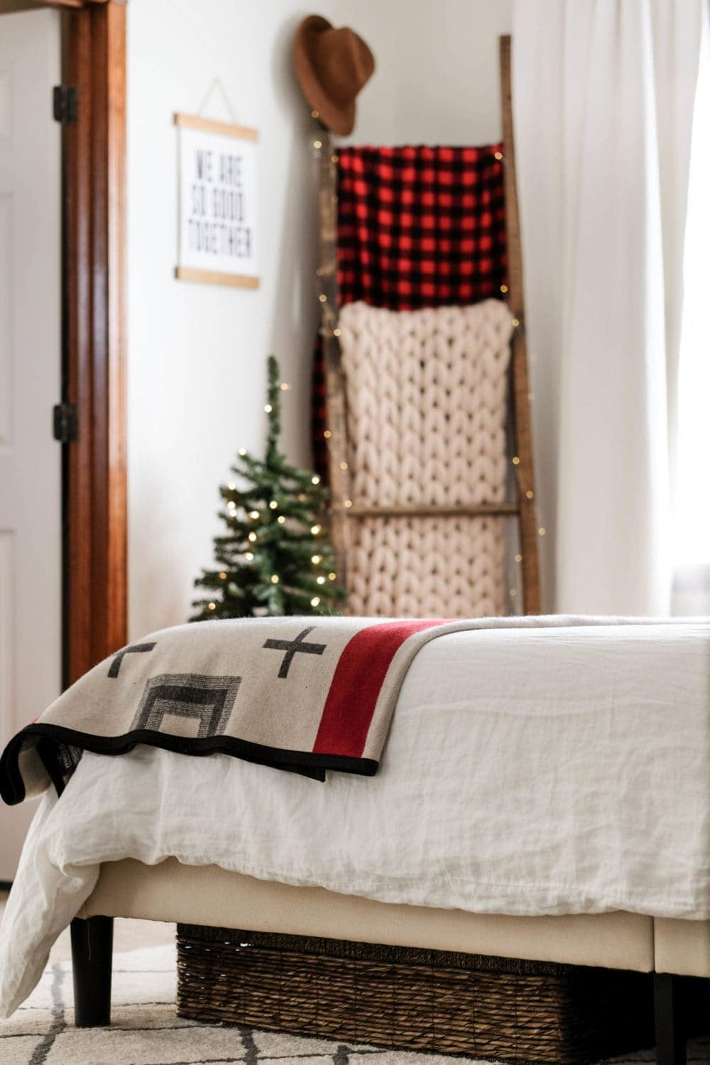 Christmas bedroom decor ideas with a blanket ladder and mini christmas tree