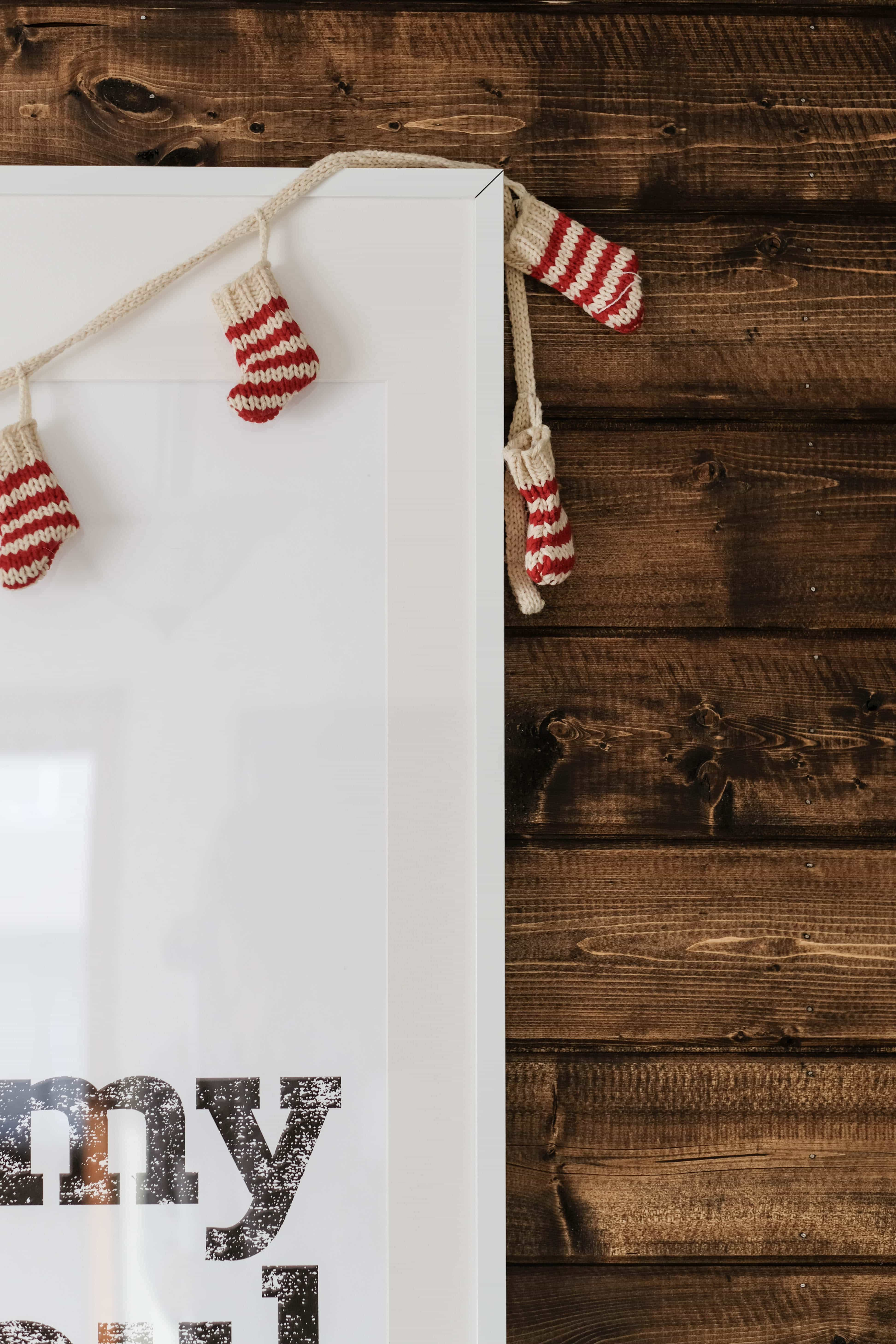 walnut shiplap accent wall with christmas stockings