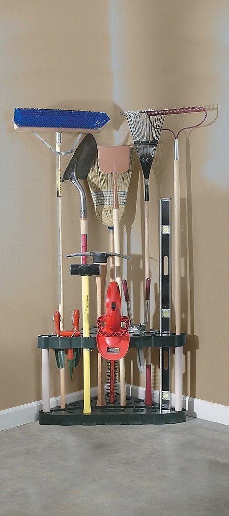 A collection of shovels, brooms, and various yard tools organized in a corner using a rubbermaid corner organizer