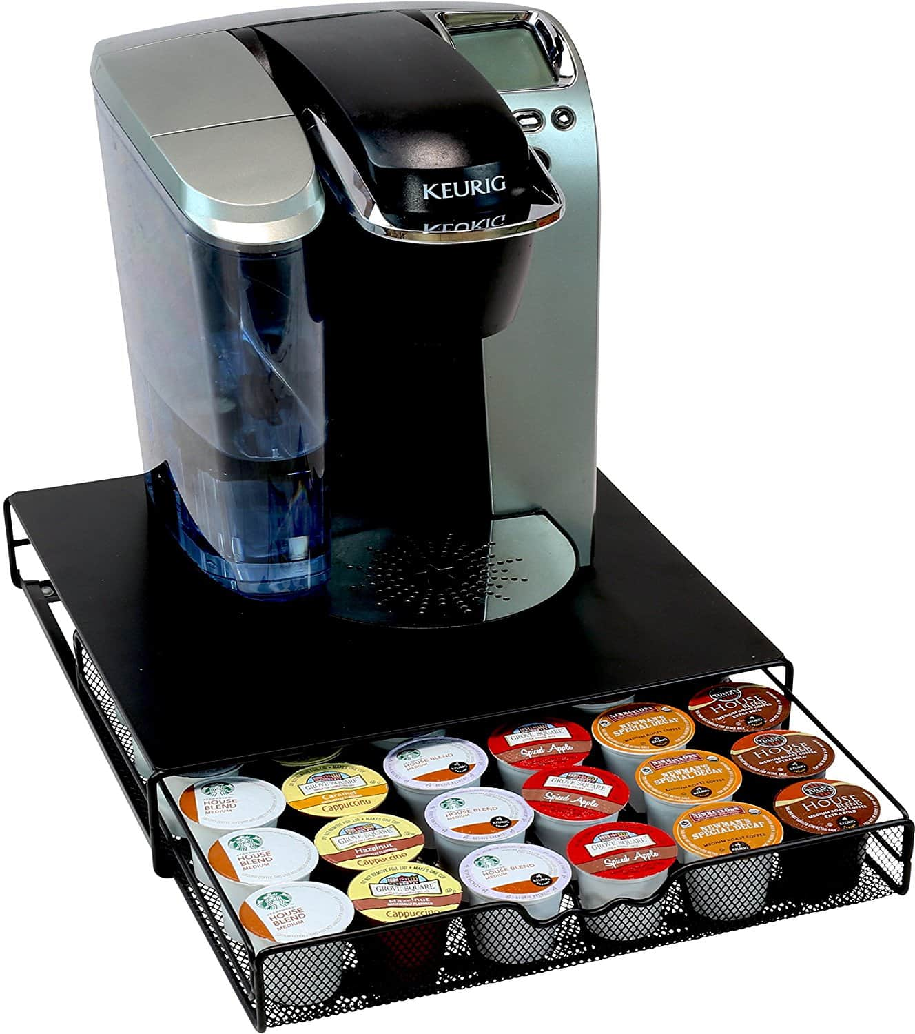 A keurig coffee machine sitting on top of a black drawer with Kcups inside