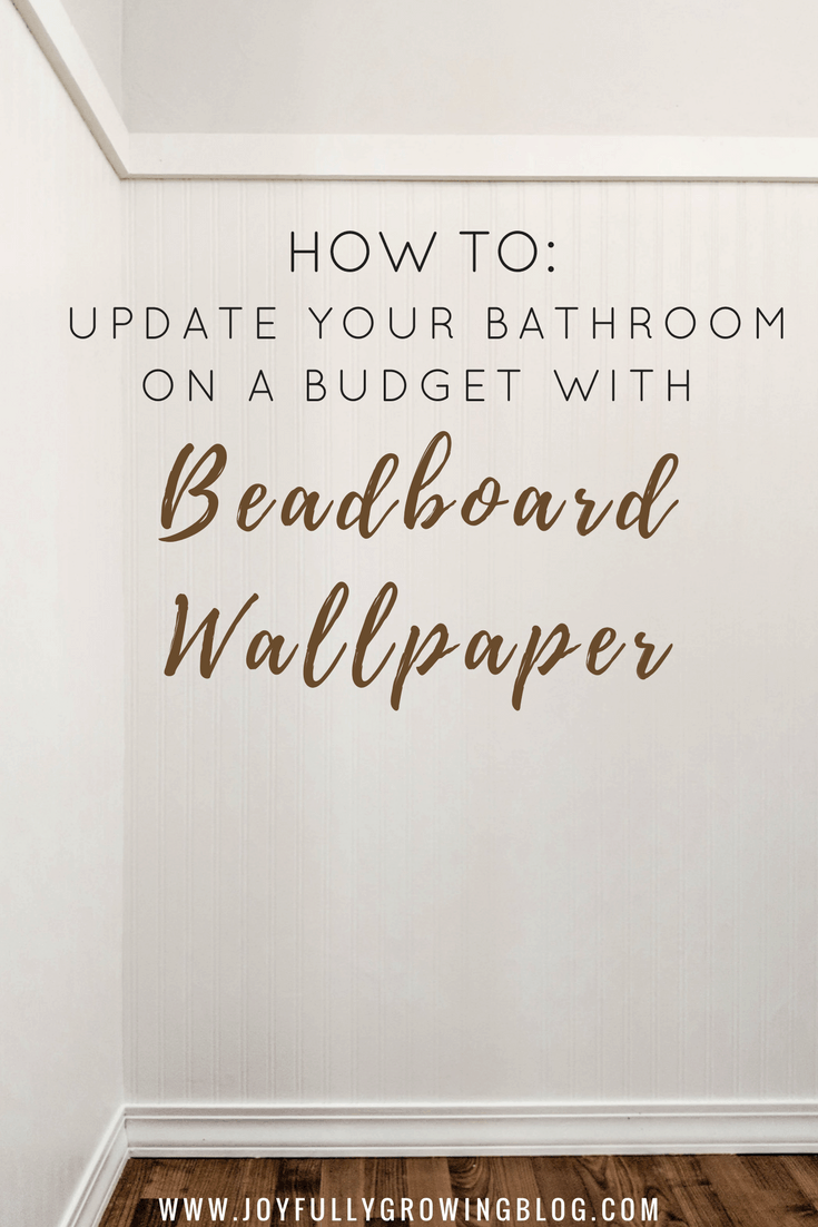 "White beadboard wall with trim and wood floors below. Text overlay says, ""How to: update your bathroom on a budget with beadboard wallpaper"""