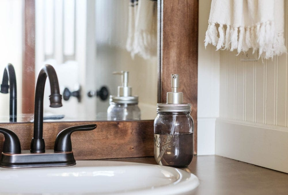 bathroom sink with oil rubbed bronze faucet and soap dispenser
