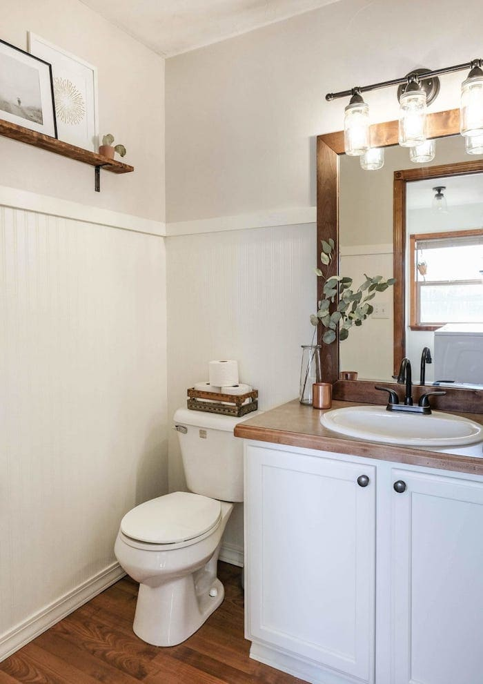 farmhouse bathroom with a painted vanity