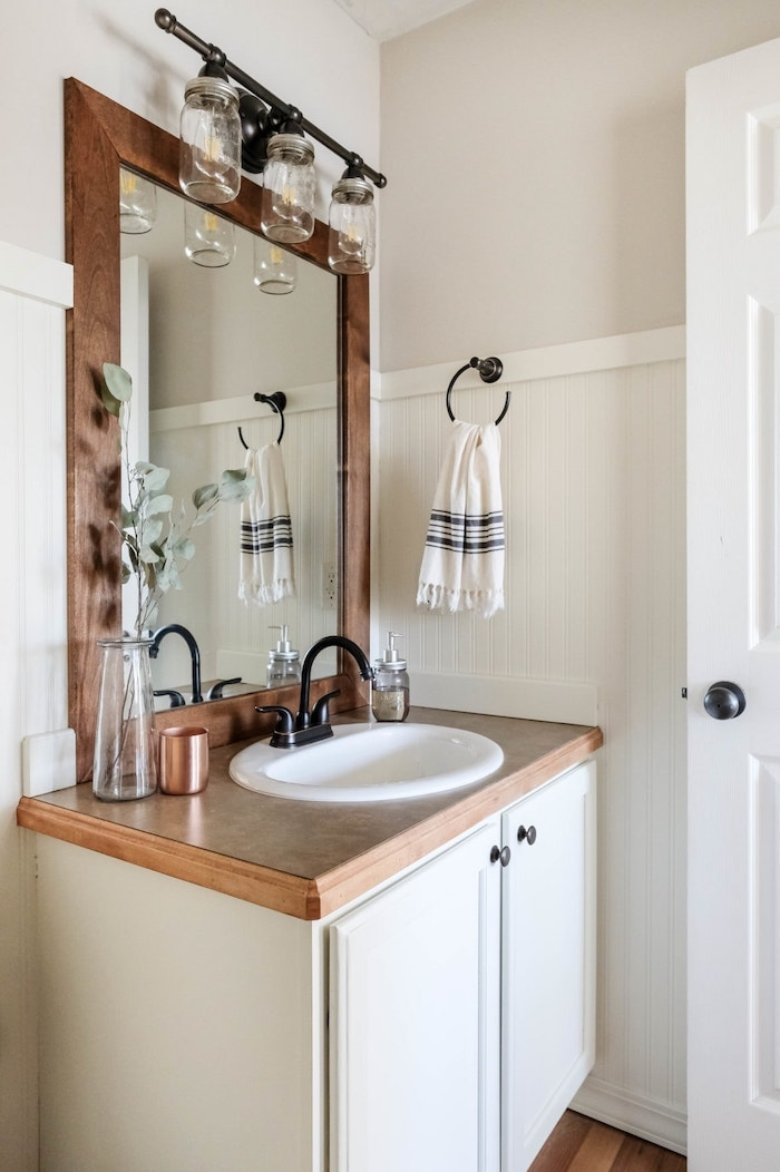 farmhouse bathroom with wood mirror frame