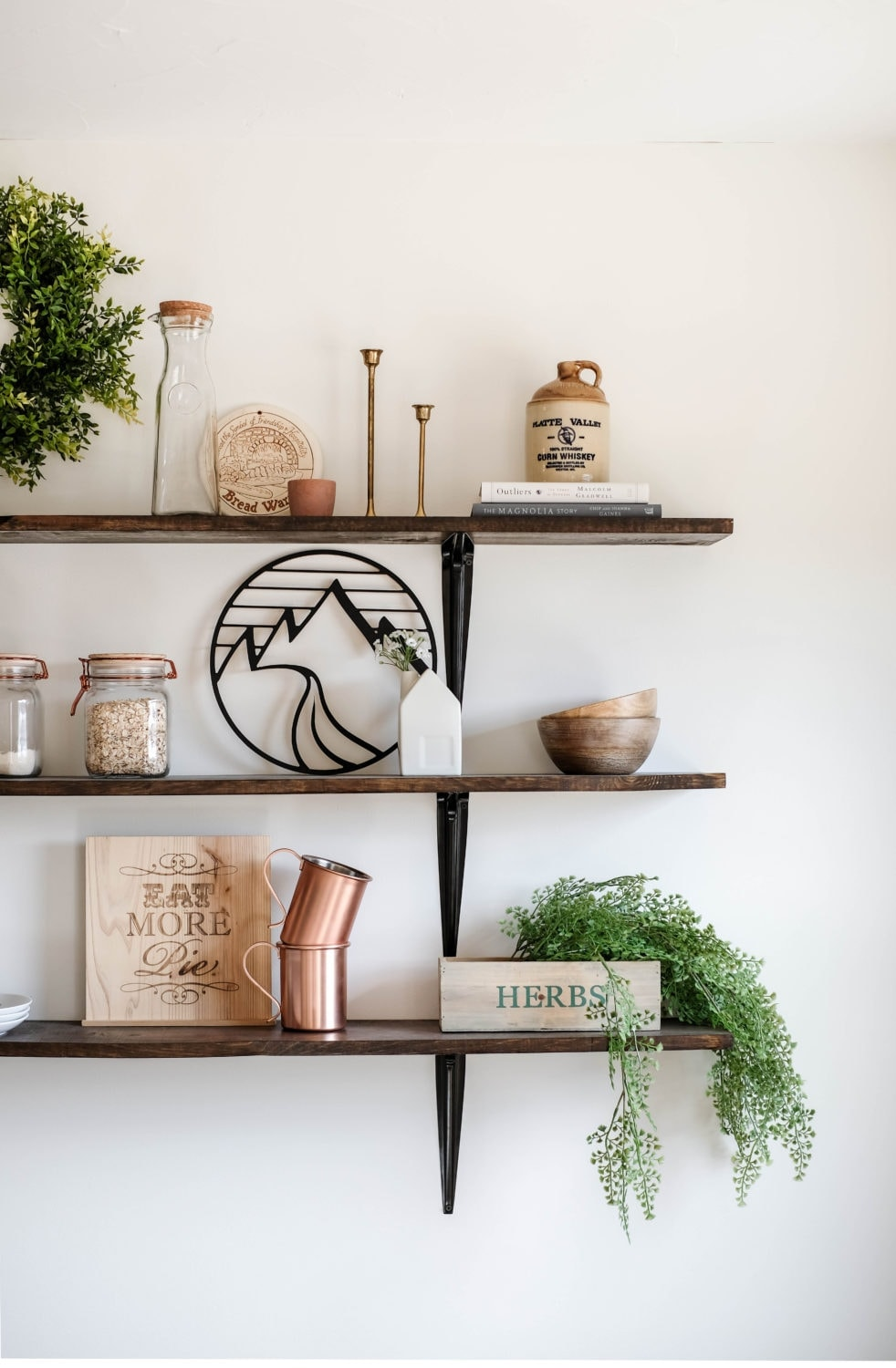 dining room shelves decorated with herbs, cups and bowls