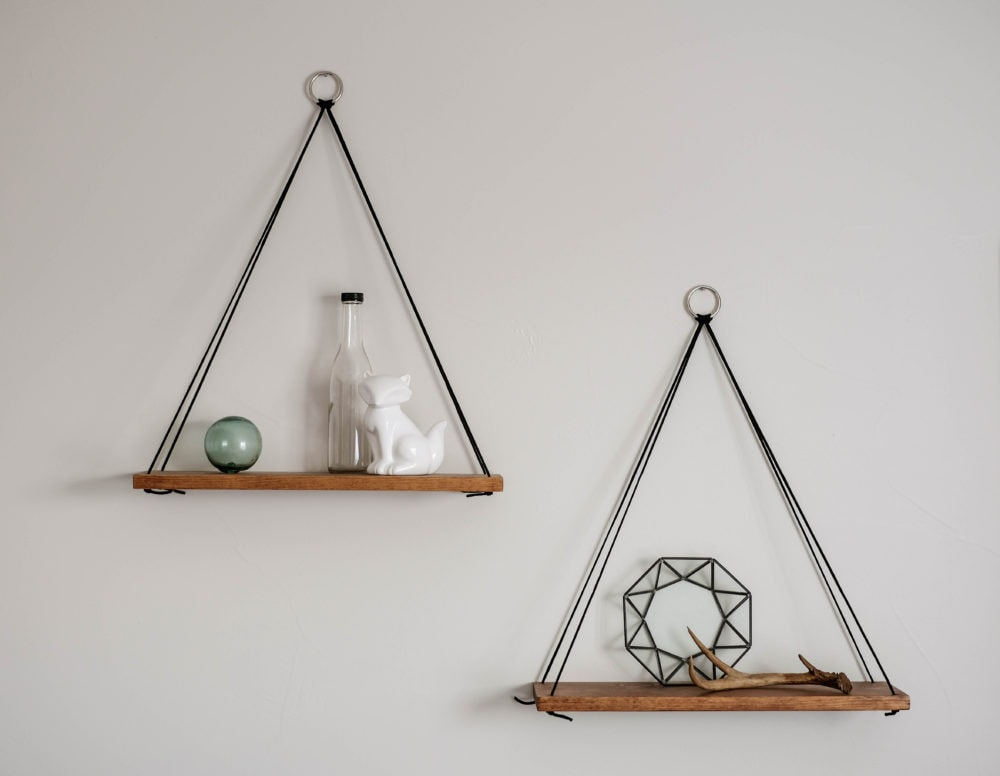 hanging shelves styled with decor