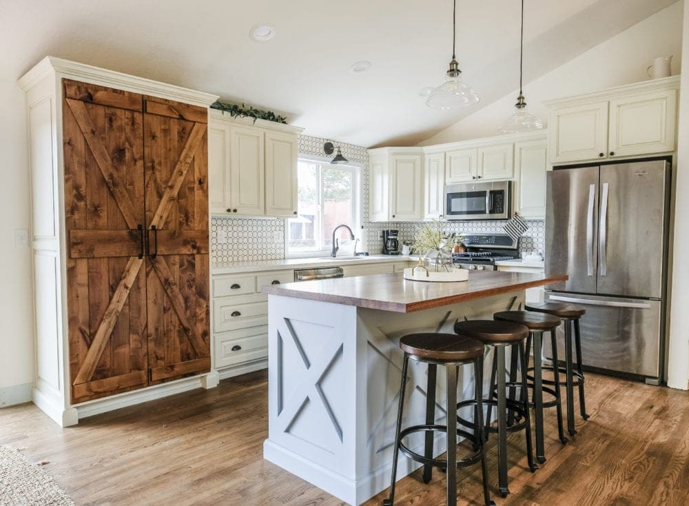 farmhouse kitchen on a budget with white cabinets and blue kitchen island