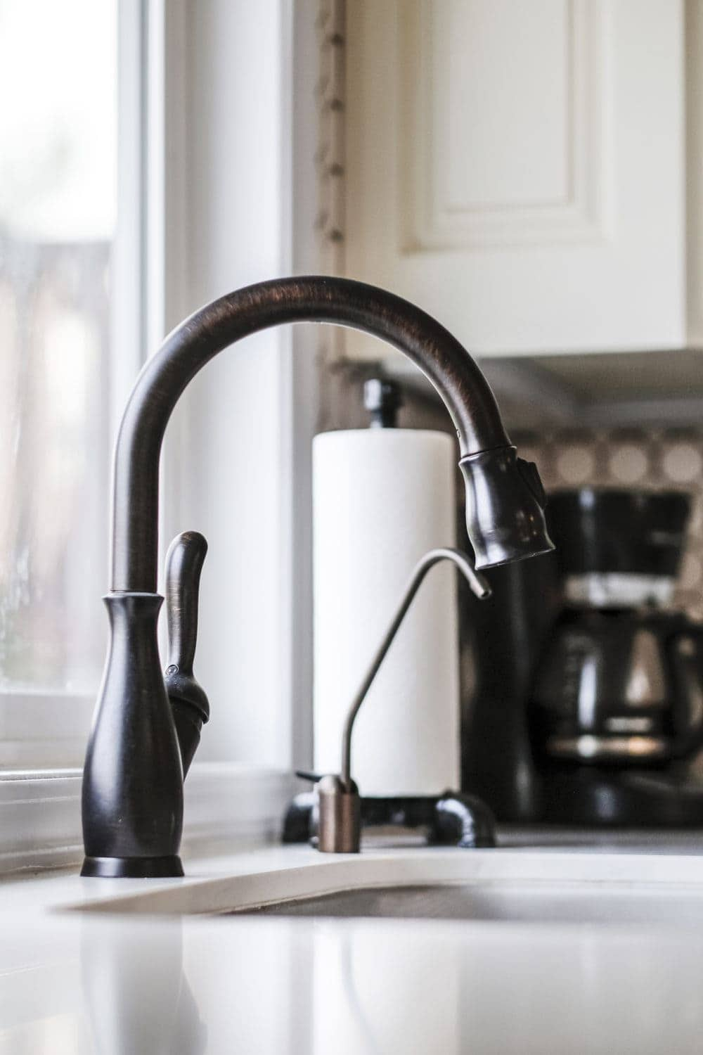 Oil rubbed bronze goose neck faucet installed over a farmhosue undermount sink