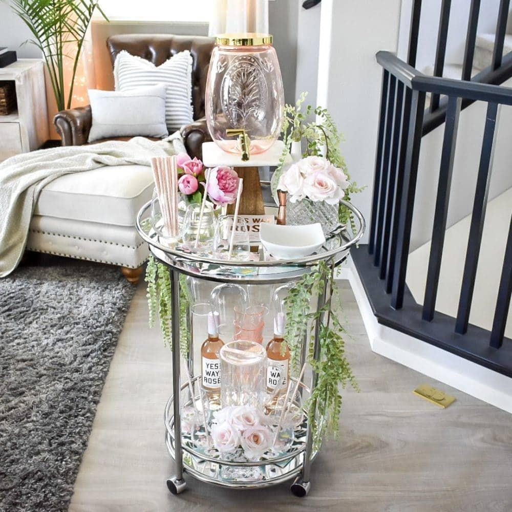 Summer bar cart with glassware and flowers