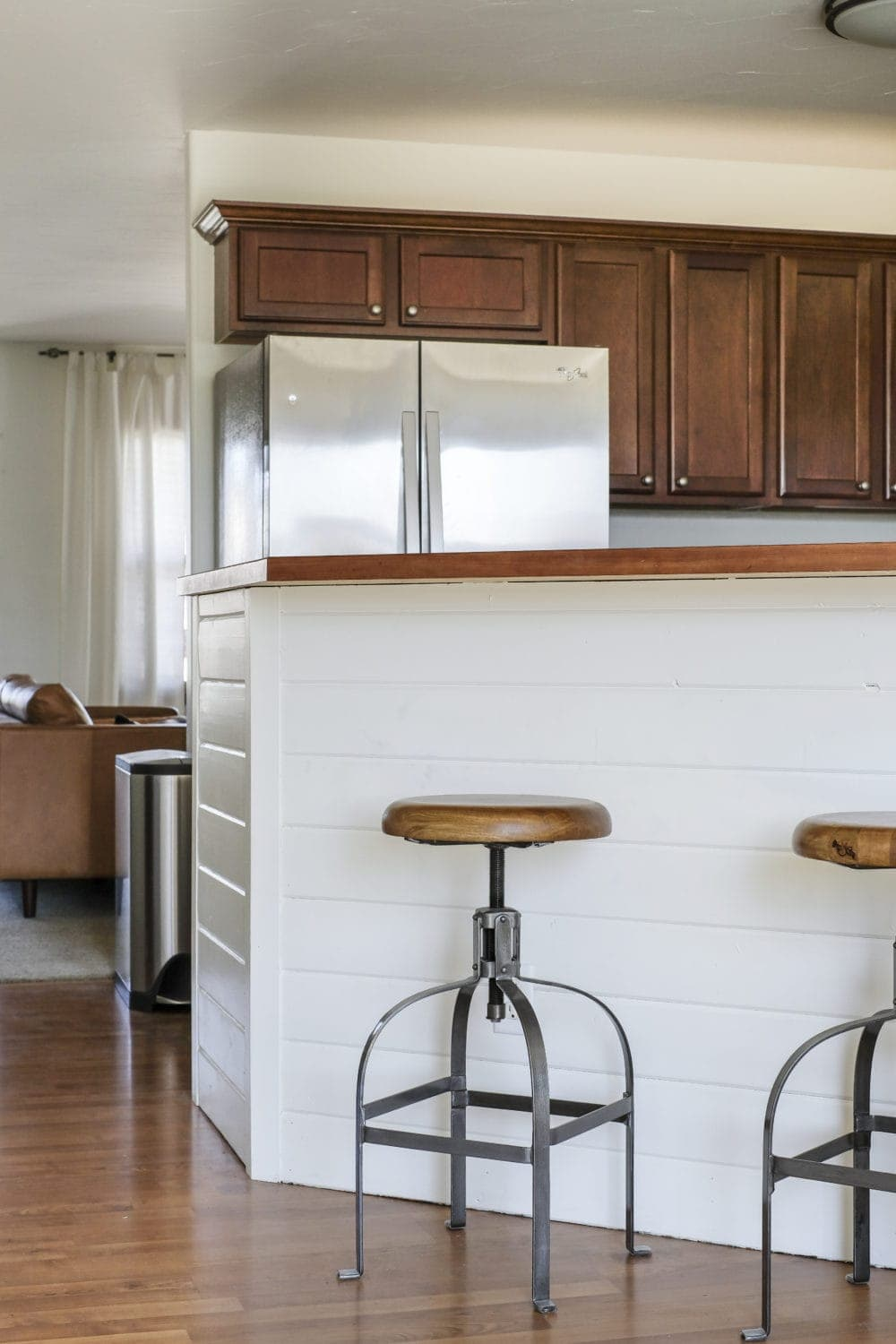 Budget kitchen breakfast bar with with DIY shiplap and rustic barstools