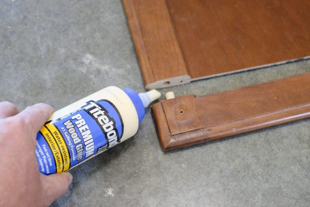 Wood glue gluing a cabinet door back together