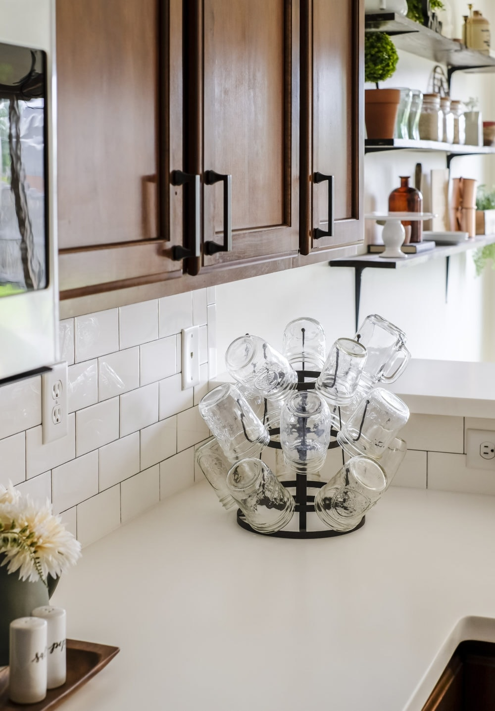 white solid surface countertops with mason jar glasses on a cup holder