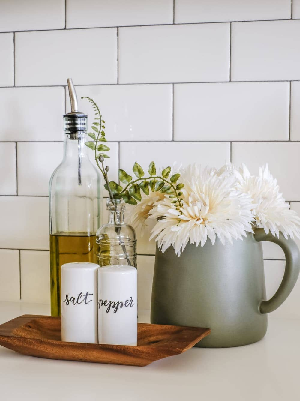 salt and pepper shakers with olive oil dispenser and flowers