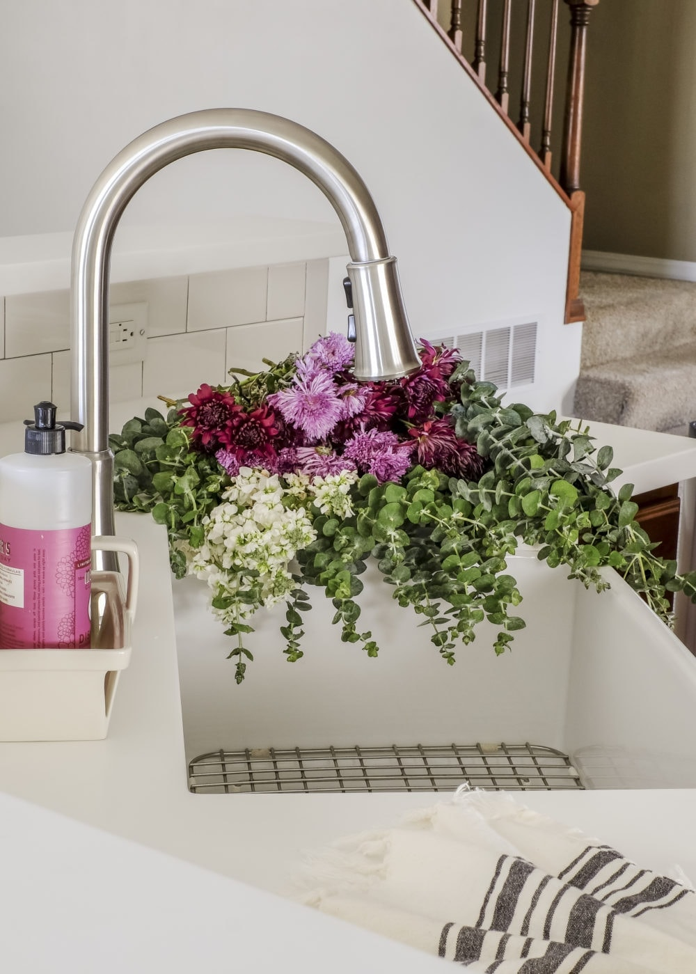 budget kitchen renovation after picture of a white farmhouse sink