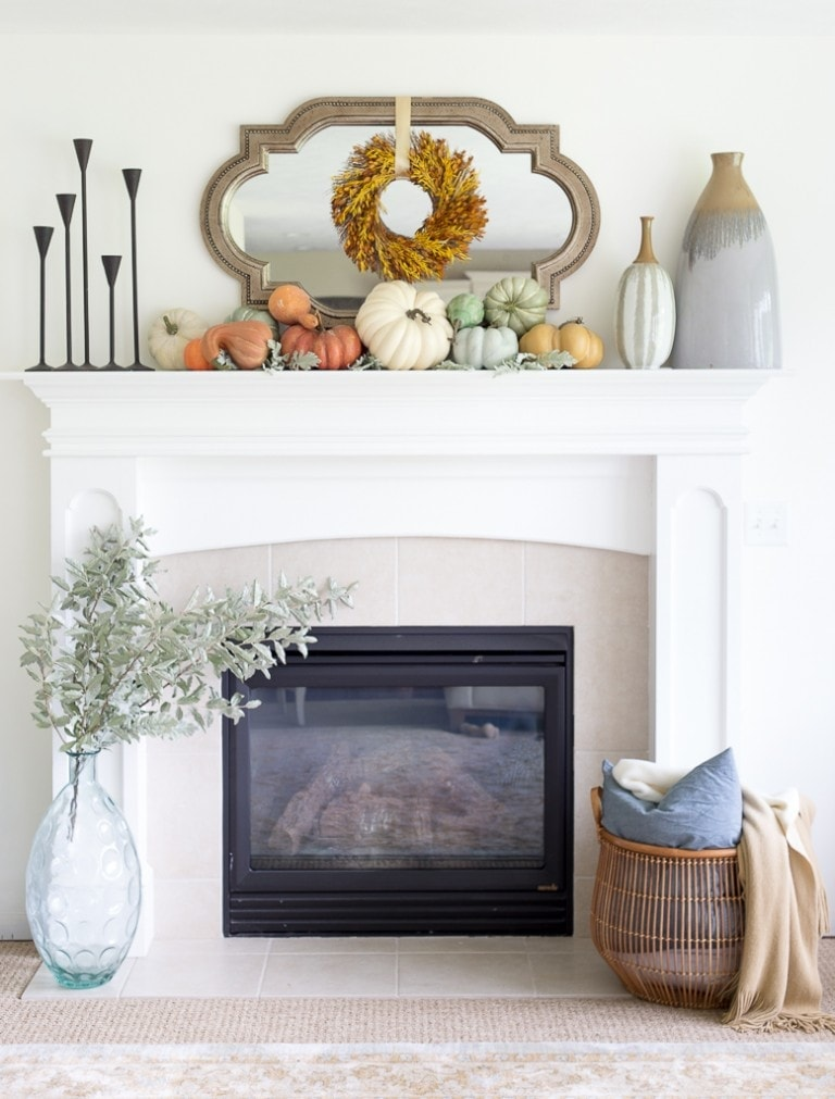 Fall mantel ideas using small pumpkins, black candle sticks and a mirror with wreath in front