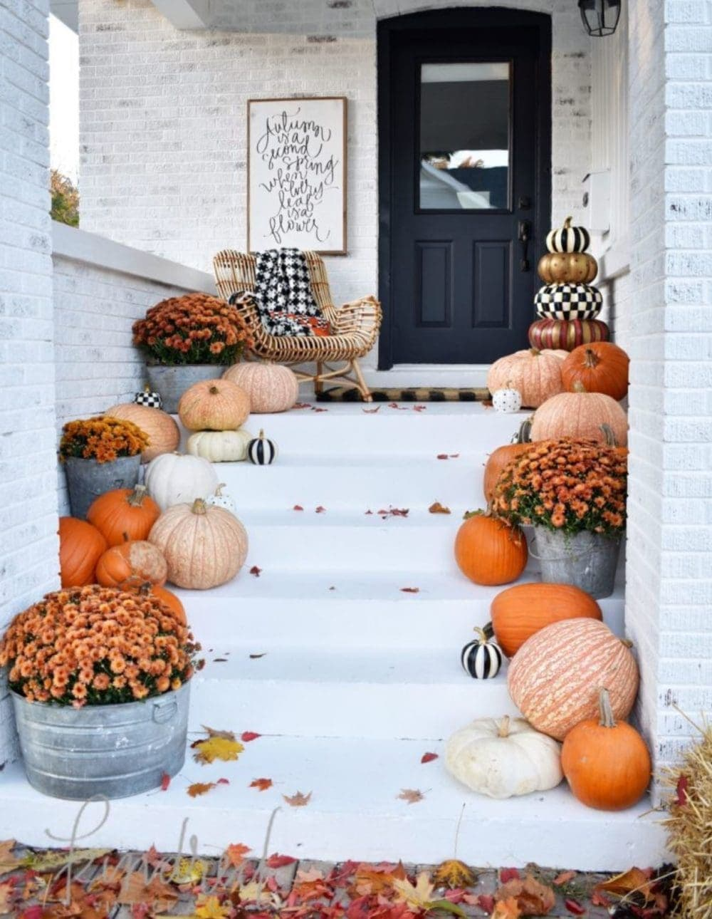 Fall front porch ideas using tons of pumpkins on each step leading to the front door