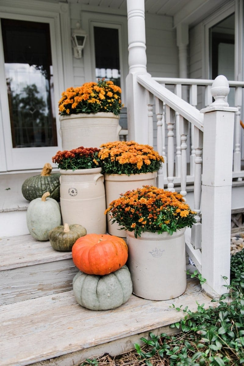 Fall front porch ideas using mums and old crocks
