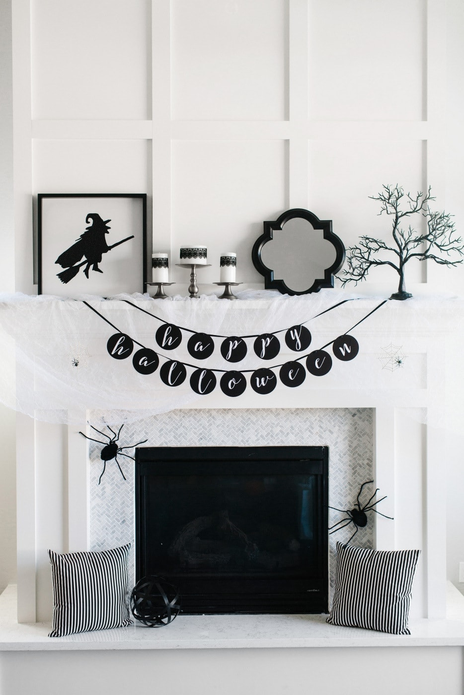 Fall mantel ideas for a halloween mantel using black and white decor and fake spiders