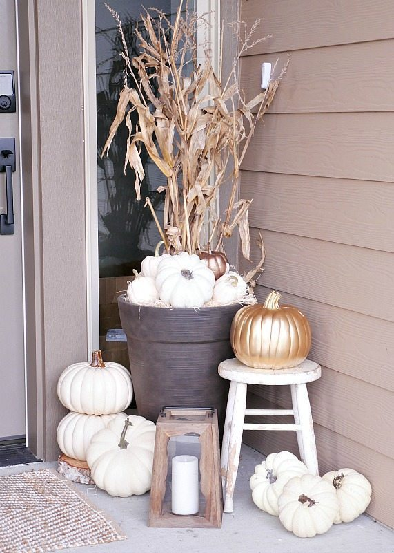 Fall front porch ideas using white pumpkins and corn stalks