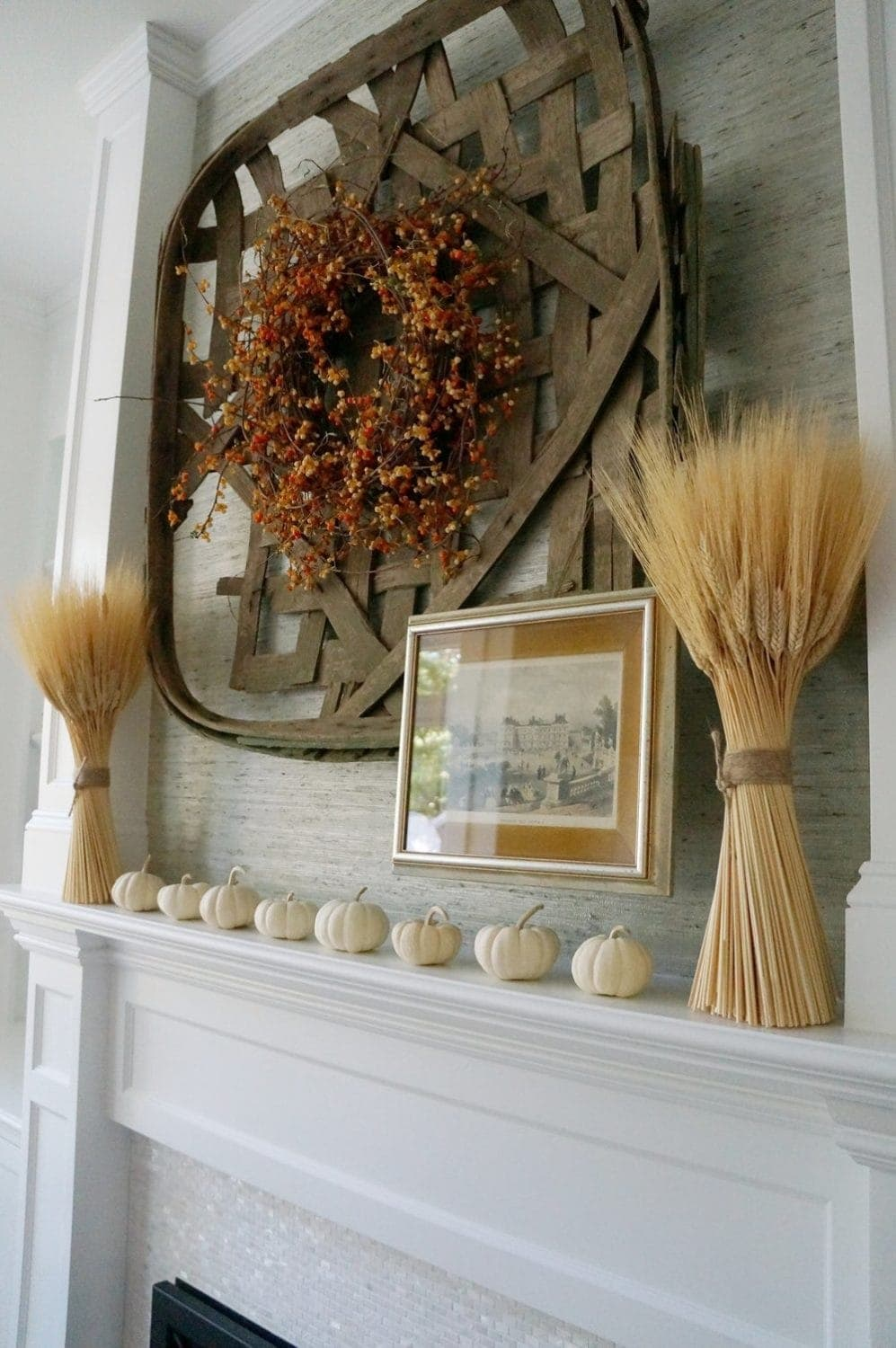 Fall mantel ideas using tobacco baskets, wreaths and dried wheat bundles