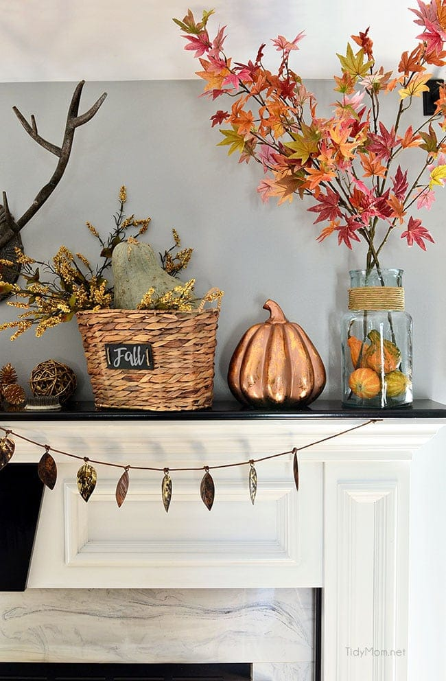 Fall mantel ideas using copper pumpkins, tree clippings and a leaf banner